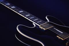 Electric Blues Guitar in Blue Stock Photos