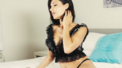 Cinematic color lingerie girl on bed Stock Footage