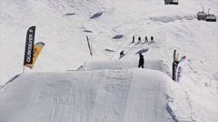 Snowboarder high jump from springboard, make sexeral full flips. Snow mountains Stock Footage