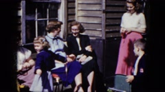 1964: a girl practices a traditional dance during a family gathering NIAGARA Stock Footage