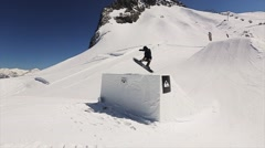 Snowboarder jump from springboard make full flip in air. Landscape of snowy Stock Footage