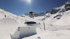 Skier jump from springboard make full flip in air. Landscape of snowy mountains Stock Footage