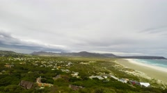 The scenic Noordhoek beach with dramatic sky in winter Stock Footage