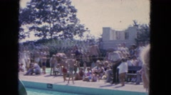 1965: a large get-together at a swimming pool outdoors CALIFORNIA Stock Footage