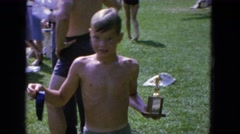 1965: kid showing prize after an event CALIFORNIA Stock Footage