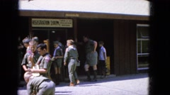 1965: a boy scout troop gathered about outdoor a building CALIFORNIA Stock Footage
