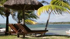Sunchair on sunny beach in Mauritius Stock Footage