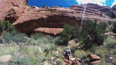 Fay Canyon Arch With Admiring Hiker- Sedona Arizona Stock Footage