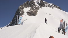Skier make flip in air, ride on slope. Landscape of snowy mountains. Ski resort Stock Footage