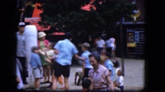 1965: people checking out a unique attraction at an amusement park. CALIFORNIA Stock Footage