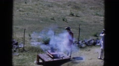 1965: three person trying to make fire with a device in the open air CALIFORNIA Stock Footage