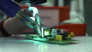 Scientist Soldering Pads On The Device Stock Footage
