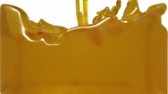 Turbulent yellow liquid filling the frame. syrup Stock Footage