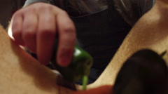 Cook taking vegetable out of grocery bag from inside Stock Footage