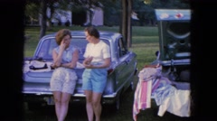 1965: ladies and gentlemen talking and socializing at a neighborhood yard  Stock Footage