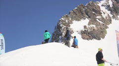 Snowboarder jump from springboard grab board in air. Blue sky. Ride in slope Stock Footage