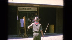 1965: boy scouts registering at camp with camping and fishing gear CALIFORNIA Stock Footage