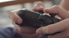 Close up of boy hands using game controller, in the end throwing the controller Stock Footage