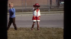 1967: a little girl dressed as a cowboy, shooting a toy pistol. DETROIT LAKES Stock Footage