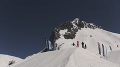 Skier jump from springboard spinning in air, failing. Snowy mountains. Blue sky Stock Footage