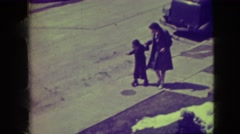 1945: mother helping child learn to roller skate NEW YORK Stock Footage
