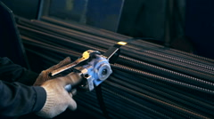 Ironworks plant. Worker packing fittings Stock Footage