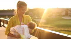 Woman dandling her baby Stock Footage