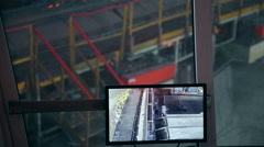 Ironworks plant. Burning Hot Billet moving on monitor screen Stock Footage