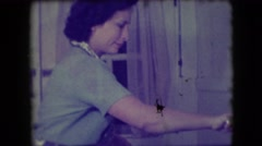 1946: mother cook food cutting chicken back posed NEW YORK Stock Footage