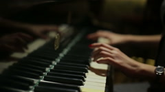 Female hands playing the piano closeup Stock Footage