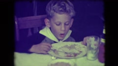 1946: a cute young boy eating and talking about the food on his plate NEW YORK Stock Footage