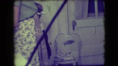 1946: a boy is dutifully drying and stacking dishes for his mother  Stock Footage
