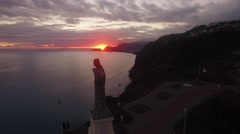 Statue of Cristo Rei, Madeira at sunset aerial view Stock Footage