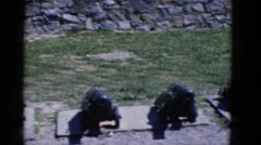 1964: military cannons at a fort as two people walk in the background Stock Footage