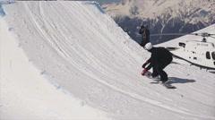 Snowboarder high jump from springboard. Make dangerous flip. Cameraman. Sunny Stock Footage