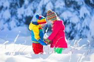 Children playing in snowy winter park Stock Photos