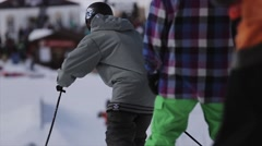 Skier ride from slope, jump on springboard. People. Encamp. Extreme. Mountains Stock Footage