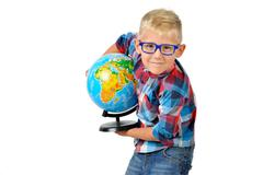 Funny boy in glasses with a geographical globe. Educational concept. Isolated Kuvituskuvat