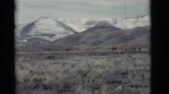 1964: view of mountain ranges showing foothills and then snow-capped peaks  Stock Footage