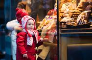 Kids looking at candy and pastry on Christmas market Stock Photos