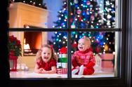Kids playing at fireplace on Christmas eve Stock Photos
