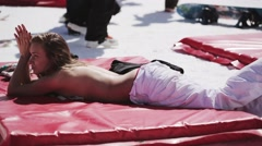 Blonde girl sunbathing on inflatable mattress. Ski resort. Encamp. Sunny day Stock Footage