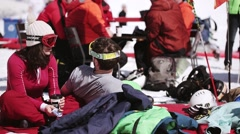 People relax on inflatable mattress. Ski resort. Encamp. Sunny day. Sunglasses Stock Footage
