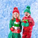 Children with Christmas presents Stock Photos