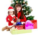 Mother with daughter near the Christmas tree Stock Photos