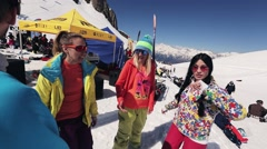 Group of friends dance on camera. Ski resort. Encamp. Sunny day. People relax Stock Footage