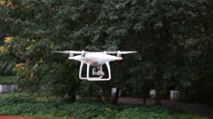 Quadrocopter while flying in the forest. Stock Footage