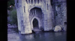 1969: a man standing in the archway of a beautiful old structure  Stock Footage