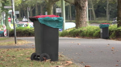 Trash cans lined up on city street for event 4k Stock Footage