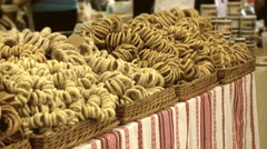 Knitted bagels in wicker boxes on a market stall, in the sale of bagels Stock Footage